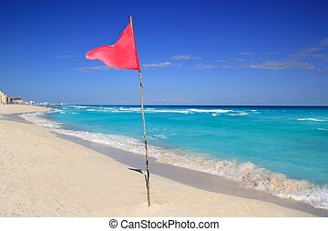 dangerous red flag in beach rough sea signal