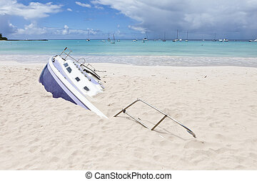 buried sailboat on the beach, barbados