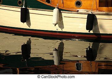 Boat Board - Board of a wooden boat with fenders