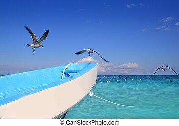 blue boat seagulls Caribbean turquoise sea