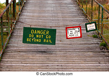 "Redundancy - Three signs ""Danger do not enter"" closing..."