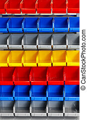 Color shelf - Colourful plastic open box container in...
