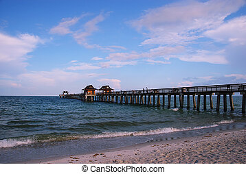 Fishing pier at Naples Beach, Florida - Fishing pier at...