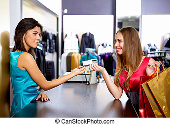 young woman in a shop buying clothes - young girl in a shop...