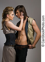 Couple - Beautiful tall couple in stylish vests and pants