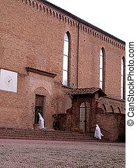 Nuns enter in the church
