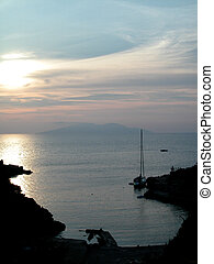 Bay with sailboat landscape at sunset