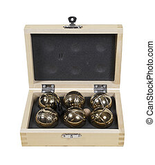 Bocce Balls Set - A set of brass bocce balls in a wooden...