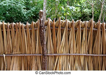 Mayan palm tree leaves wood fence in rainforest Jungle...