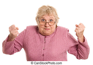 The elderly woman shows a fist