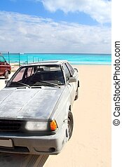 aged grunge car in Mexico Caribbean beach