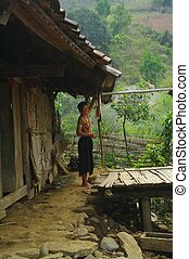 Thay ethnic woman outside her home - Tay ethnic woman...