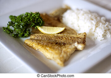 Restaurant Food - Fish and Rise Served on the Square Plate...