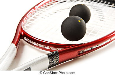 Close up of a red and silver squash racket and ball on a...