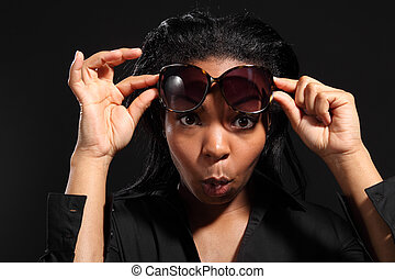 Fun expression by young girl wearing sunglasses
