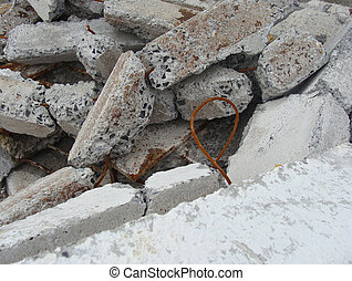 large stacked broken chunks of fortified concrete...