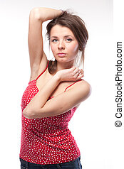 Attractive woman in red dress posing on white