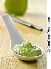 green wasabi in ceramic spoon