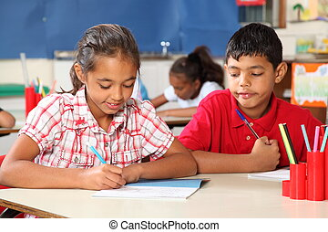 School children in class learning - Young school children,...