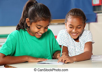School girls in class learning - Young school girls, 10,...