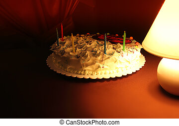 Beautiful cake in dark celebratory entourage. - Beautiful...