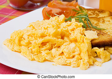Scrambled eggs and french toast - Scrambled eggs served with...