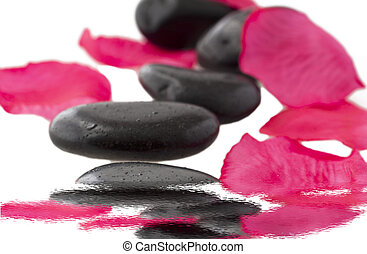 Stones - Some black stone for massage with petals of rose...