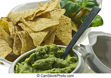 Guacamole and nachos - Guacamole in porcelain sauce boat and...