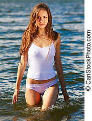 summer girl - Young beautiful slavonic girl in white wet top...