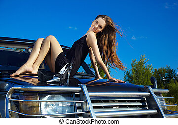 girl on off-roaders cowl - Young beautiful slavonic girl in...
