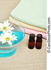 Aroma therapy concept with flowers and towels