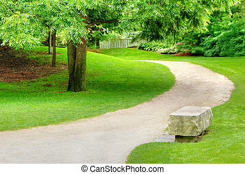 Stone bench on a gravel path