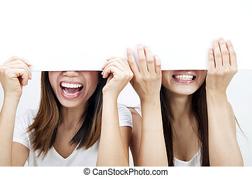 Blank paper for advertisment - Concept photo of Asian women...