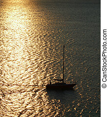 Sailing in the sunset - A sailboat in the last rays of sun
