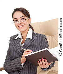 woman in the office dress - Business woman holding a notepad...