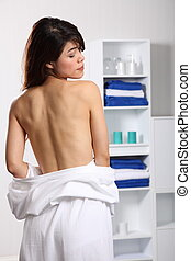 Oriental woman shows naked back - Beautiful young oriental...