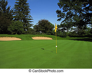 Golf Course - A photograph of a golf course in the...