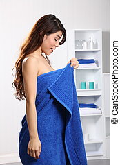 Woman checking her body under towel - Beautiful young...