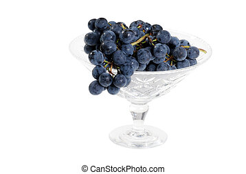 concord grapes in crystal bowl - isolated concord grapes in...