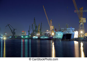 Shipyard of Gdansk at night - View of the quay shipyard of...
