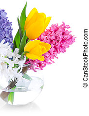 spring flowers in glass vase isolated on white background