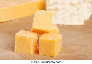 cheddar cheese and crackers focus on top cube