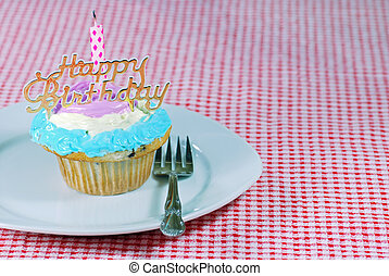 Birthday cupcake on a plate