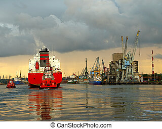Maneuvers in port - A large cargo ship enters the port...