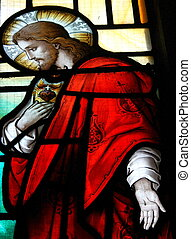Jesus - A shot of jesus on a stained glass window