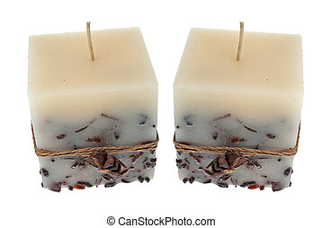 Candles - Side view of two candles isolated on white...