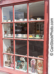 Antiques Shop Window - Crockery, china and figurines are...