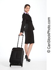Business woman with luggage - Smart business lady pulling...