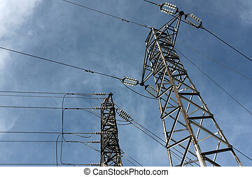 High Voltage Poles under blue Sky