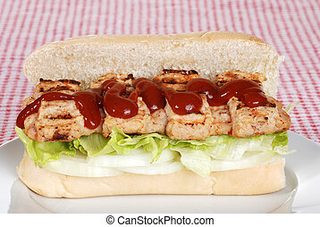 pork riblet with sauce sandwich